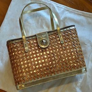 Kate Spade gold woven bucket bag.